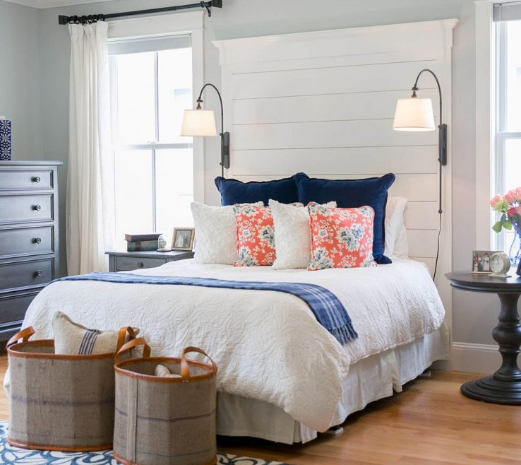 Beach E Bedroom Of A Quaint With Bright Accent Pillows