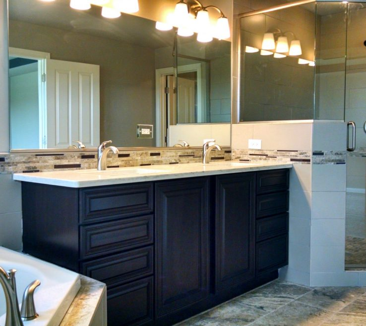 His And Her Bathroom Vanities Of Double Sink Located Between A Soaker Tub