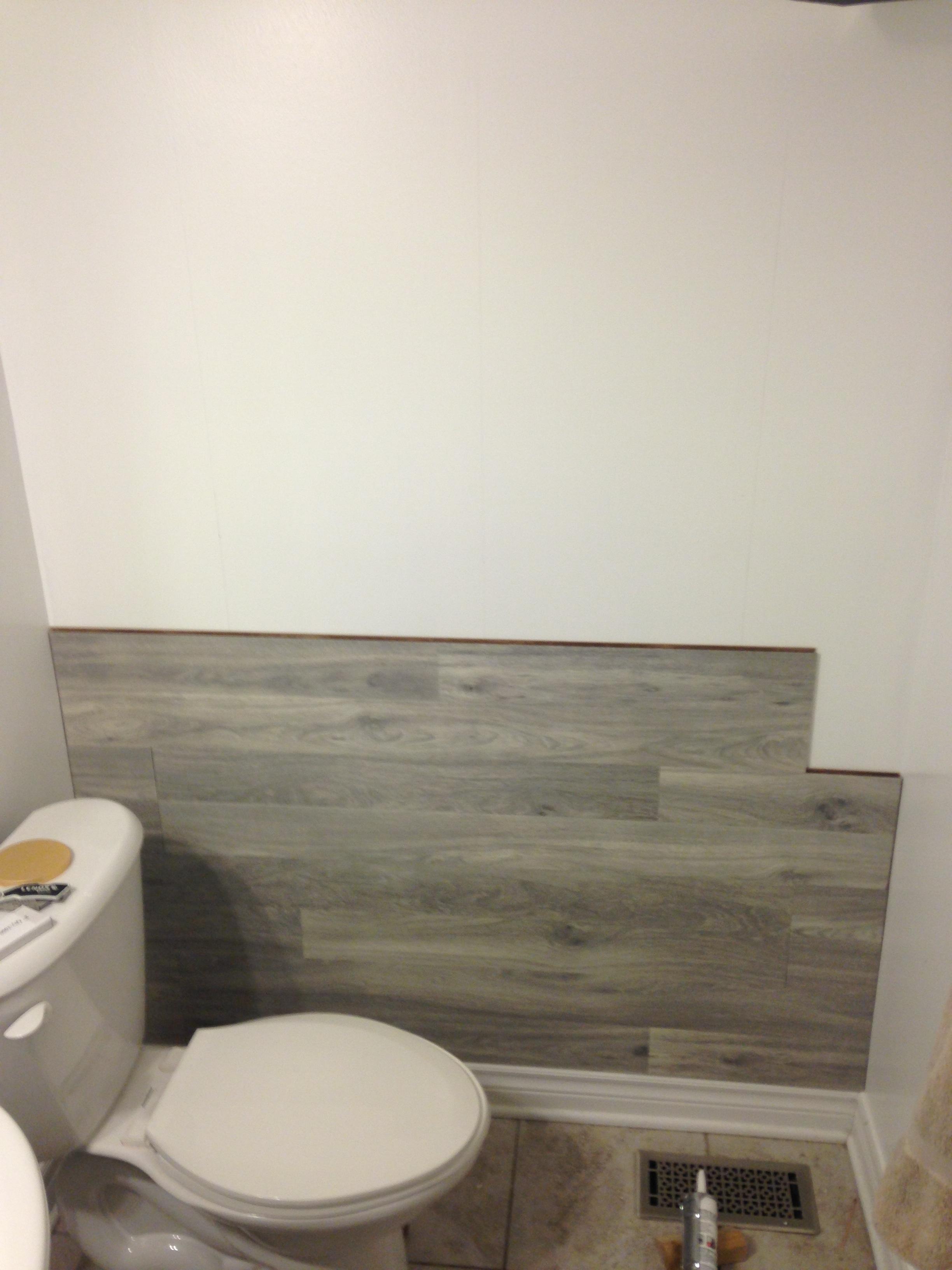 can you put laminate flooring on bathroom walls  carpet