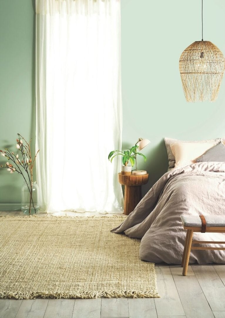Magnificent green bedroom walls of light with taupe bed linen and sheer
