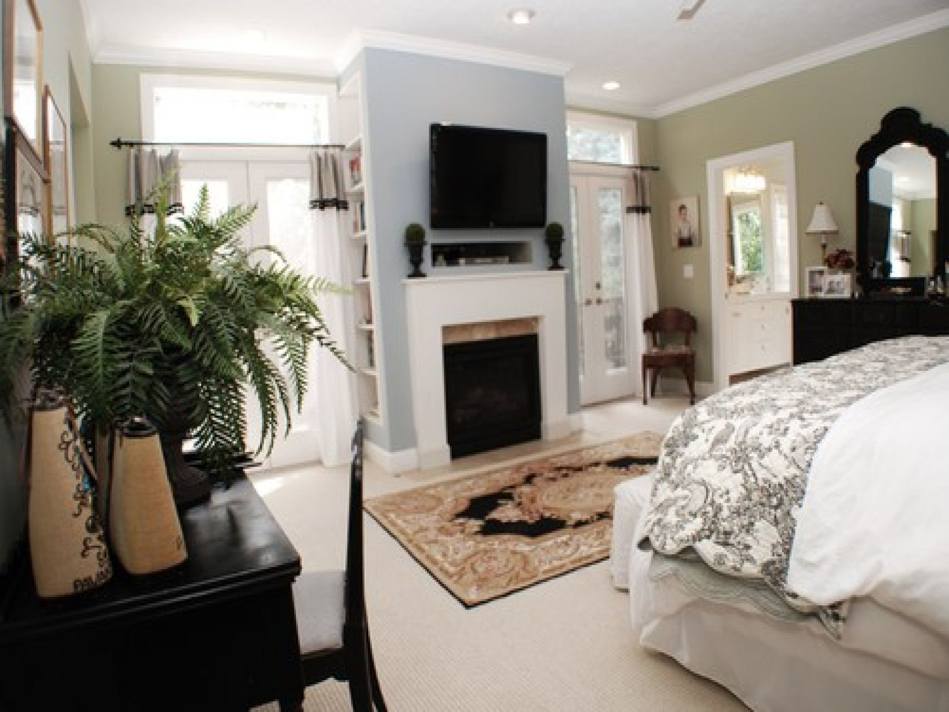 Master Bedroom With Fireplace Of Black Table Chair Entertainment