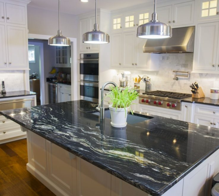 White Kitchen S With Black S Of Granite A Daring Touch Of Sophistication