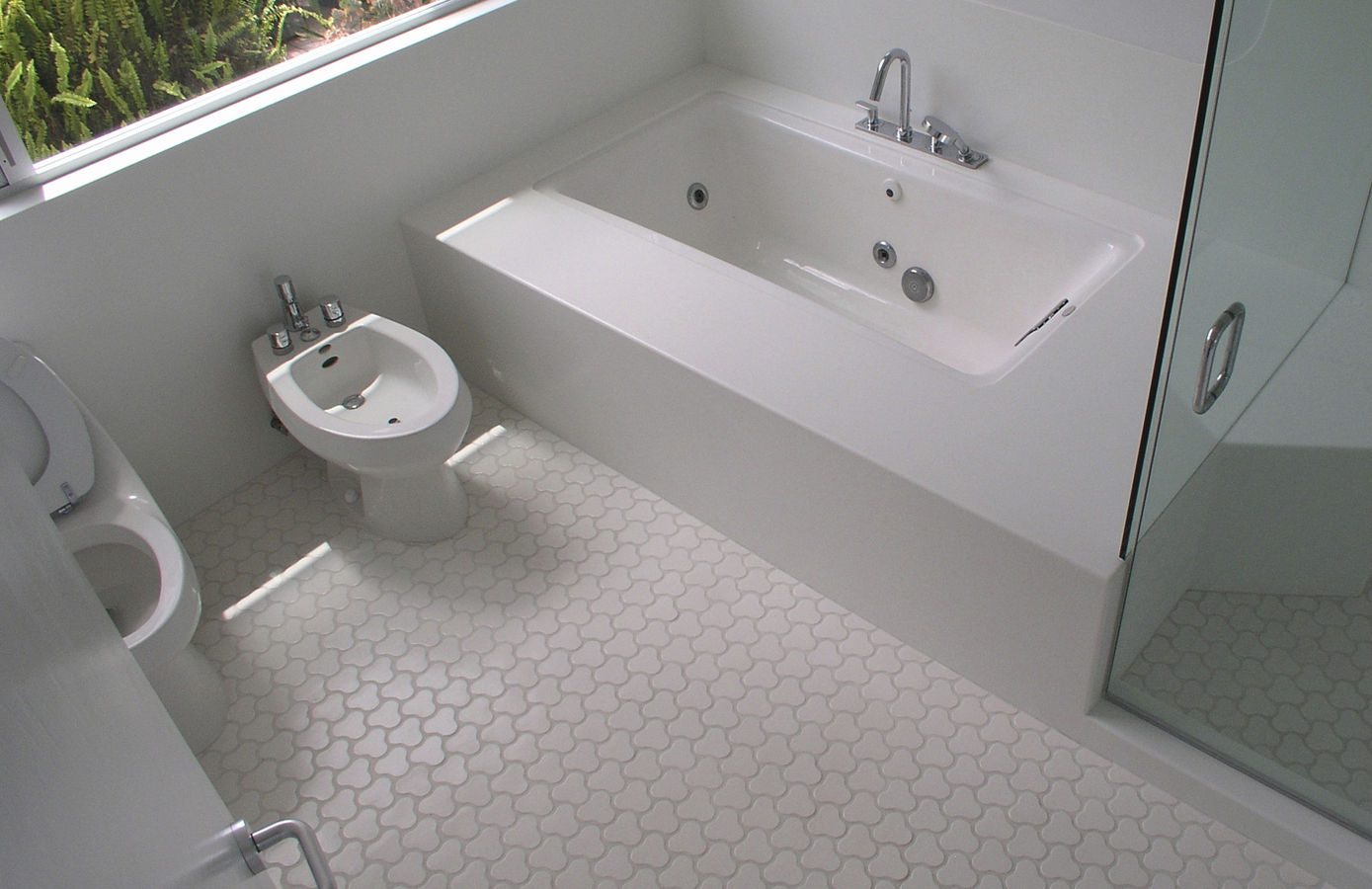 Adorable Glass Floor Tile Bathroom Of White Themed Design With Built In Bathtub