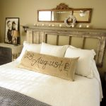 Artistic Bedroom Wall Decor Of Antique Mirror Extends Above Votive Lined Mantelpiece