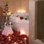 Alluring Floor Decoration Of Red Rose On The With Some Candle
