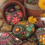 Astonishing Painted Garden Stones Of Hand Flower Motif Art