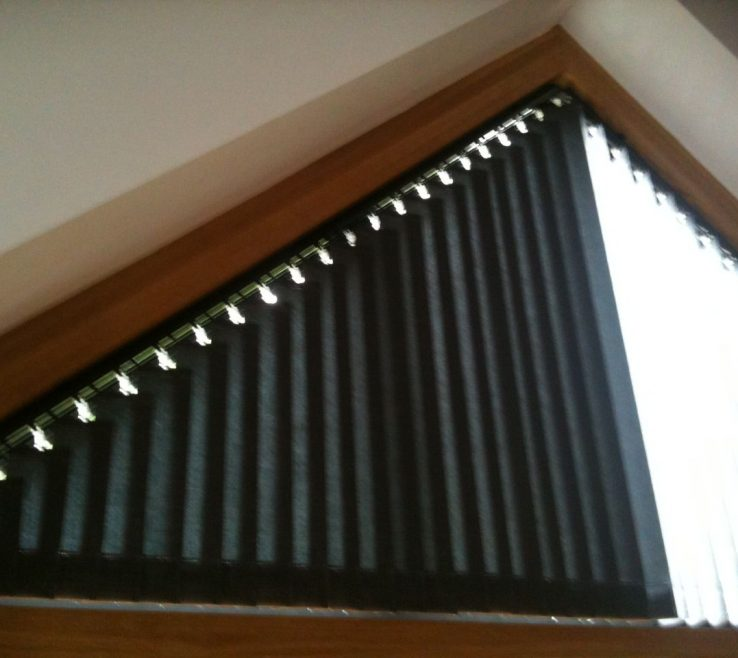 Fascinating Triangular Windows Of Part Closed Blinds In Window