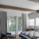 Bed In Floor Of The Bedroom Offers A Stylish Queen Size